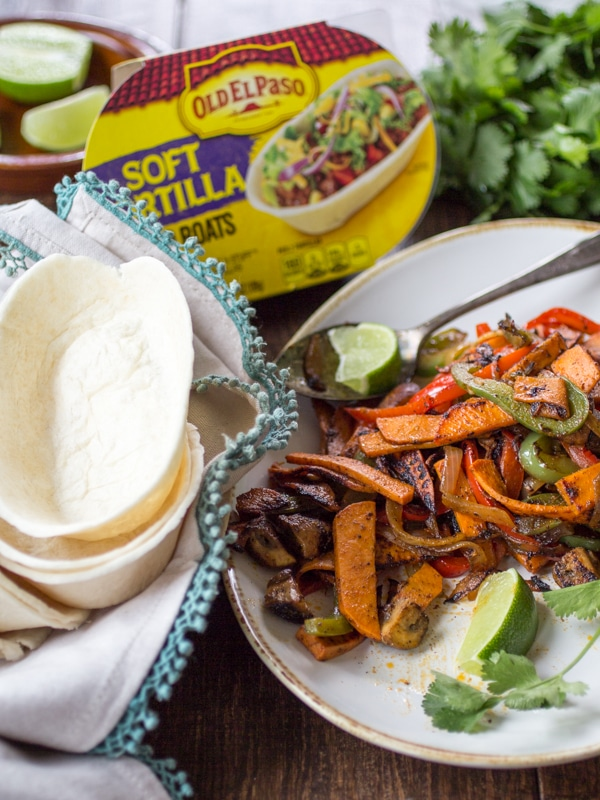 Tender sweet potato and smoky mushrooms stand in for meat in this easy vegan fajita recipe!