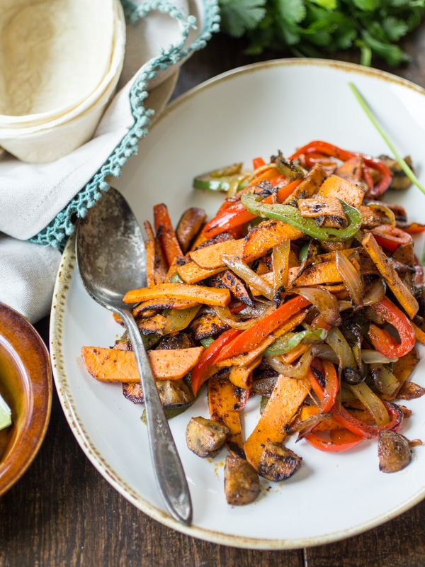 Looking for Vegan Sweet Potato Recipes?  Here is a great one!  Vegan Sweet Potato Fajitas | Tender sweet potato and smoky mushrooms stand in for meat in this easy fajita recipe!