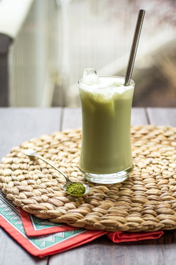 A simple concoction of matcha powder, sugar, milk, and ice makes up this easy green tea latte iced!