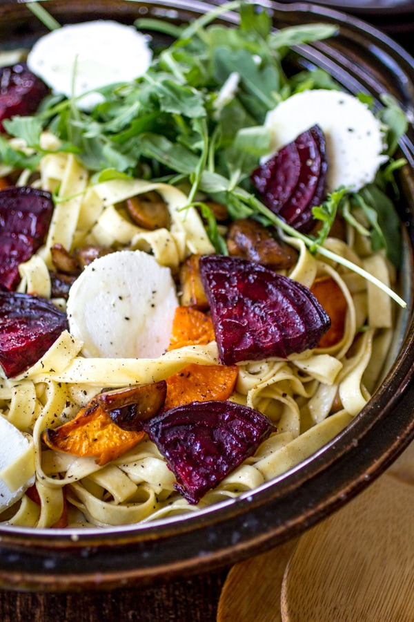 Fresh Pasta with Sweet Potato, Beet, and Goat Cheese | Roasted vegetables, tangy goat cheese, peppery arugula, and nutty almonds transform plain fettuccine noodles into a dinner worth craving!