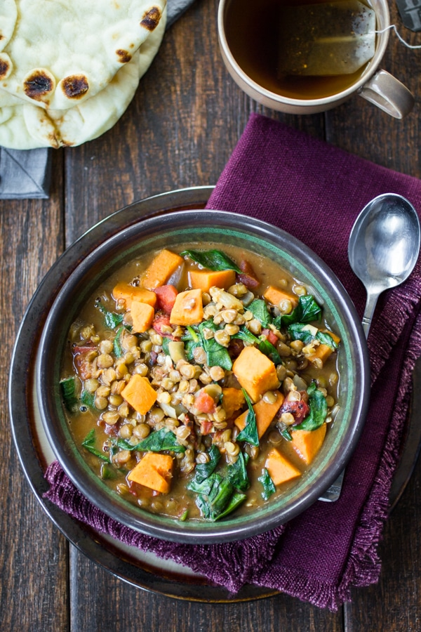 Creamy Vegan Ethiopian Lentils | Savory sweet potato, tender lentils, and fresh spinach are simmered in a Berbere-spiced coconut milk broth.This is one of my all-time favorites for cold weather and lazy weekends. I love to save the leftovers in mason jars for easy lunches during the week!
