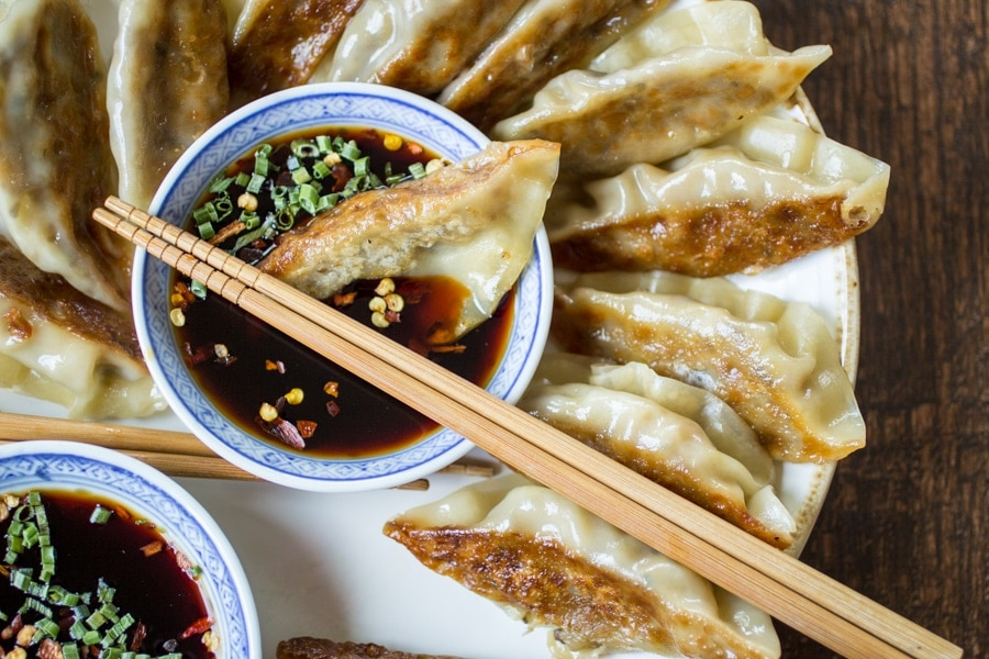 Spicy Sichuan Vegan Potstickers | Humble cabbage and mushrooms are perfectly spiced to bring bold flavor to these little pieces of heaven.