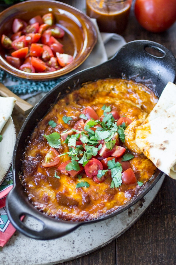 Colorado sauce made from smoky peppers adds a kick to this meatless queso fundido recipe. Serve it hot with plenty of tortillas and chips for dipping!