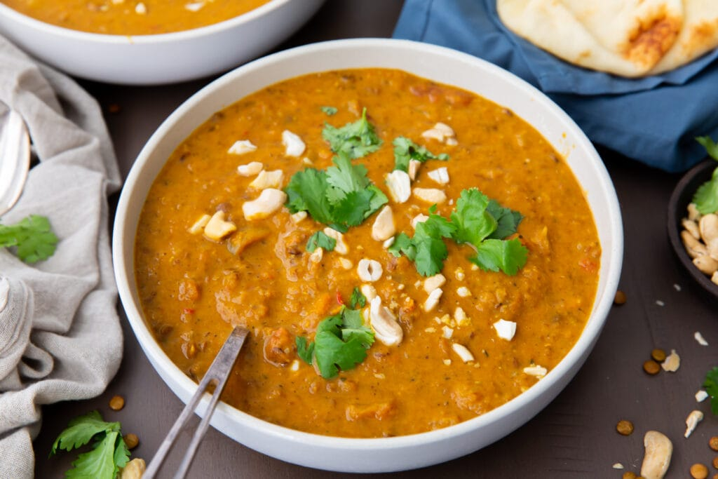 Looking for vegetarian Indian recipes? Try this one! This fragrant Indian Mulligatawny Soup recipe is spiced with curry and made from creamy red lentils, carrots, apples, and coconut milk.