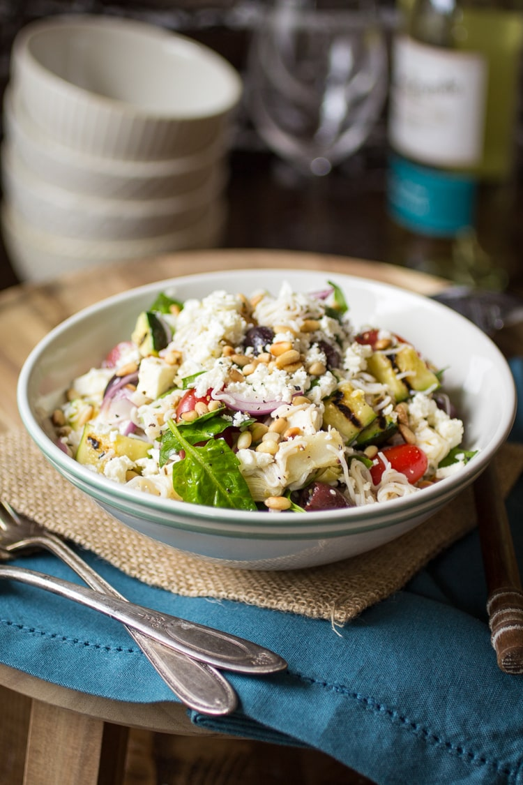 Mediterranean Pasta Salad gets a lightened-up makeover using tofu shirataki noodles. Studded with tomatoes, zucchini, artichokes, and olives, this is one potluck dish that everyone will love!