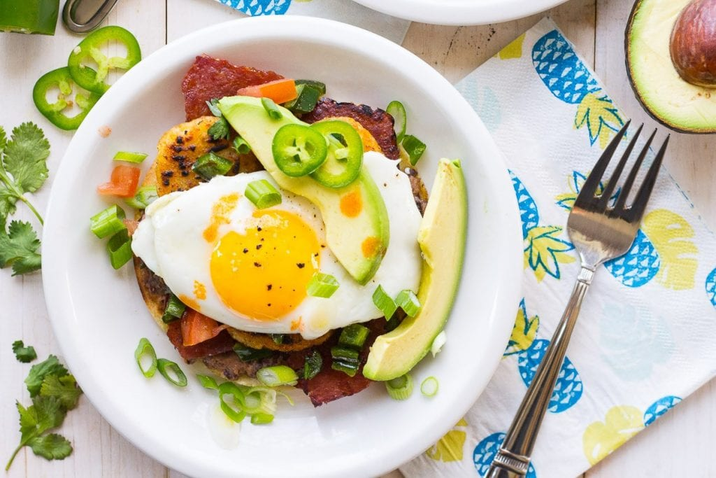 Super Easy Breakfast Tostadas | 10 Vegetarian Runny Egg Recipes | These meatless recipes are loaded with drippy eggs, veggies, and plenty of avocado!