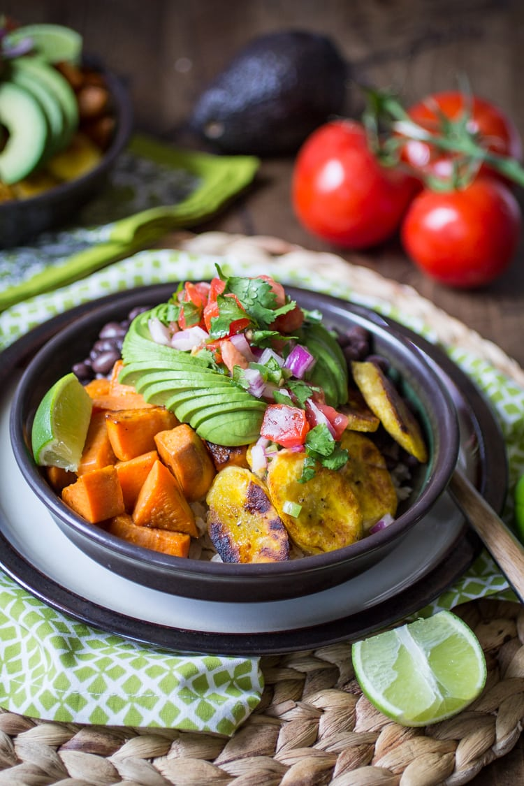 Vegan Cuban Bowl - one of my all-time favorite dinners! Brown rice, black beans, fried sweet potatoes and plantains, topped with avocado, pico de gallo, and lime. Perfection!