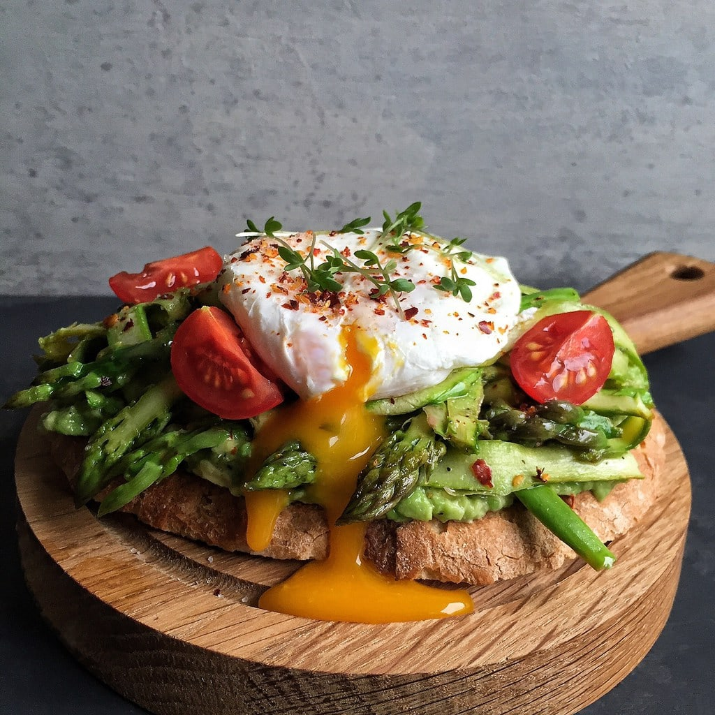 Mashed Avocado Toast with Sauted Shaved Asparagus and a Poached Egg |10 Vegetarian Runny Egg Recipes | These meatless recipes are loaded with drippy eggs, veggies, and plenty of avocado!