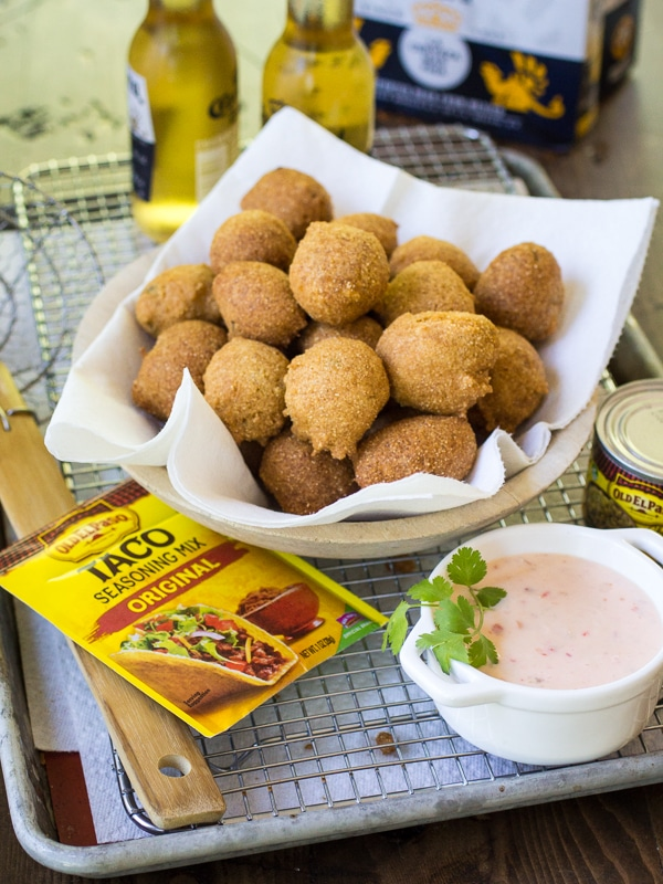 Pepper jelly dipping sauce is the perfect sweet-and-spicy accompaniment to these fried Mexican Hushpuppies!