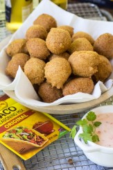 These Mexican Hushpuppies are made with taco seasoning, green chiles, and Corona for a fun twist on an old favorite!