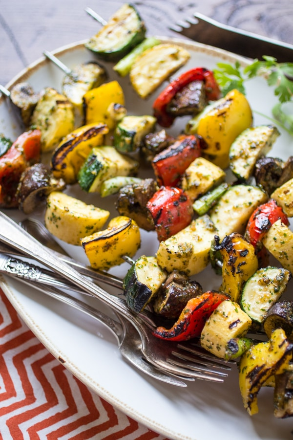 A cilantro-heavy marinade is the star in this versatile recipe for Spicy Thai-Style Grilled Veggie Skewers. An easy side-dish for a summer BBQ, these veggies can also take the center stage when served atop a bowl of rice or noodles. This recipe makes a great veg barbeque or veg barbecue, no matter how you spell it!