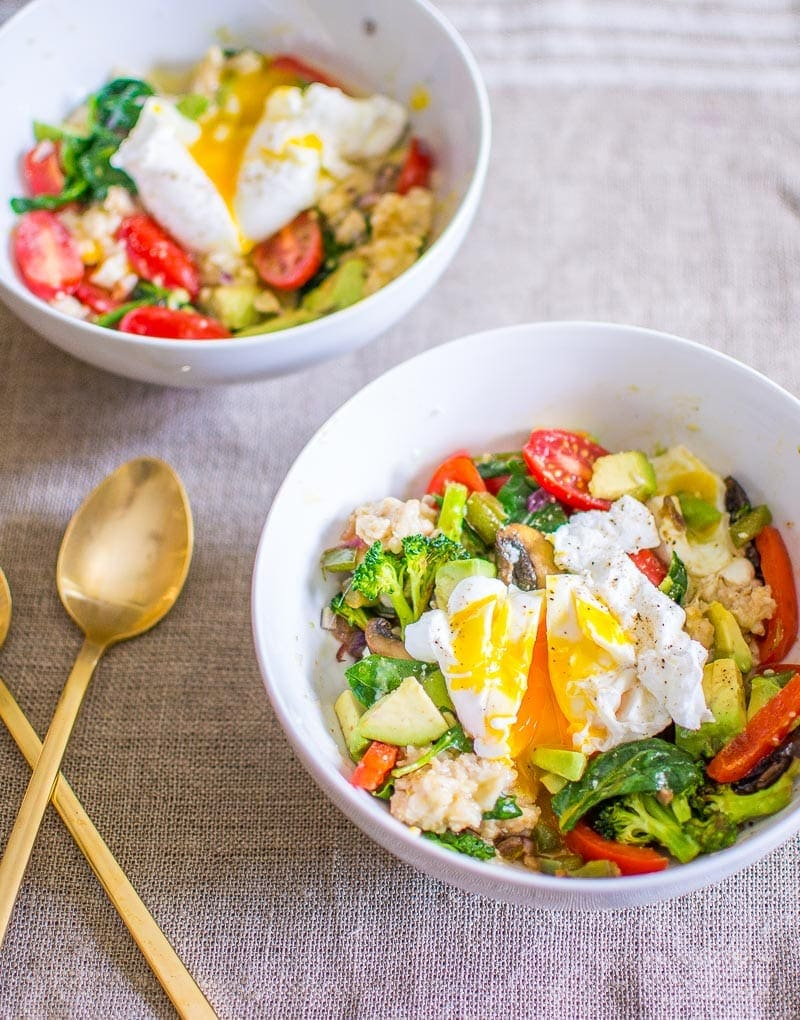 Savory Oatmeal Breakfast Bowls | 10 Vegetarian Runny Egg Recipes | These meatless recipes are loaded with drippy eggs, veggies, and plenty of avocado!