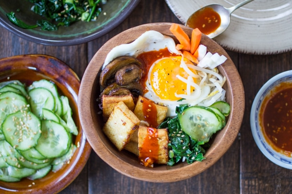 Vegetarian Tofu Bibimbap | 10 Vegetarian Runny Egg Recipes | These meatless recipes are loaded with drippy eggs, veggies, and plenty of avocado!