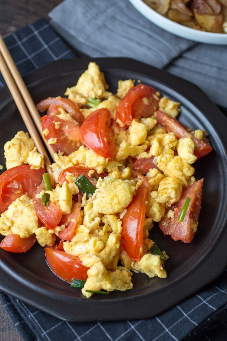 Chinese Tomato Eggs are as simple as they are surprising - perfect for breakfast, lunch, or dinner!