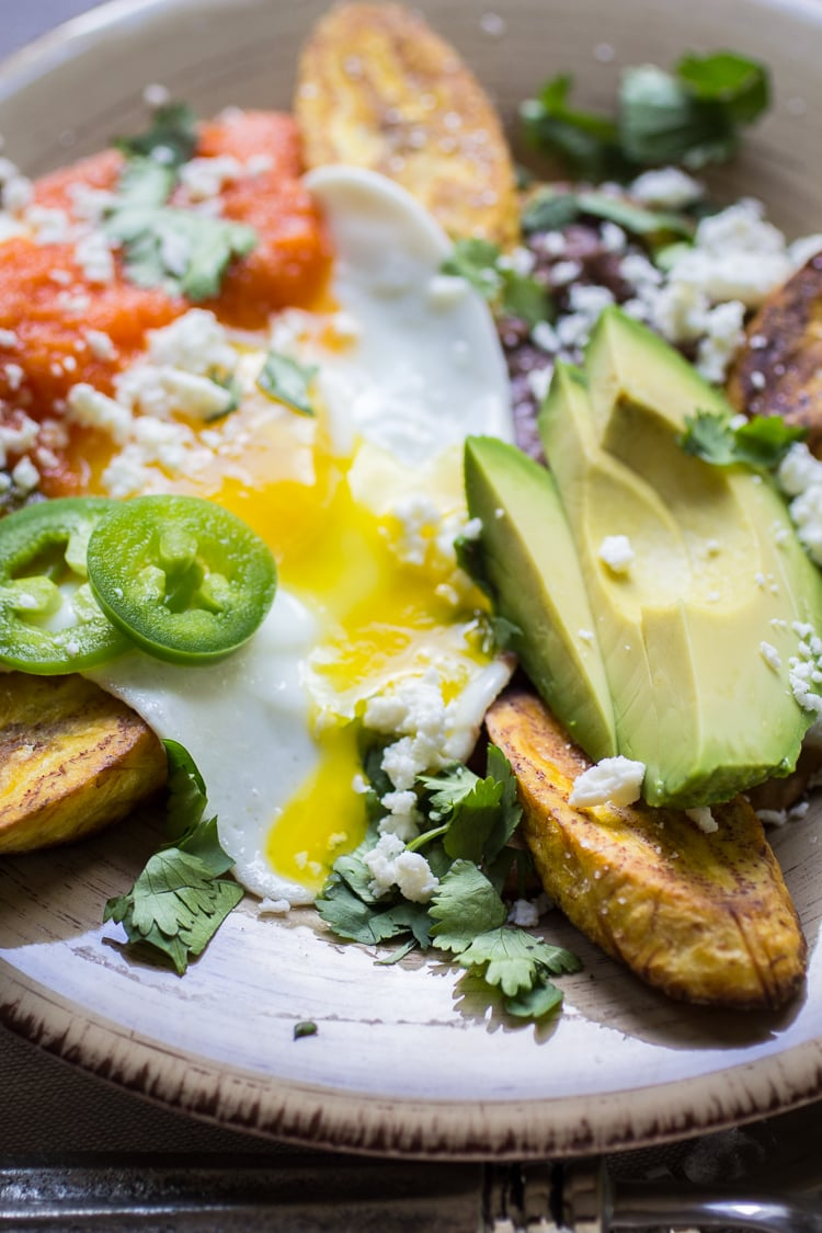 Huevos Motulenos is the perfect breakfast-for-dinner recipe. Just fry a tortilla, top it with beans, a fried egg, and a quick red sauce. Garnish with avocado, cilantro, and jalapenos!