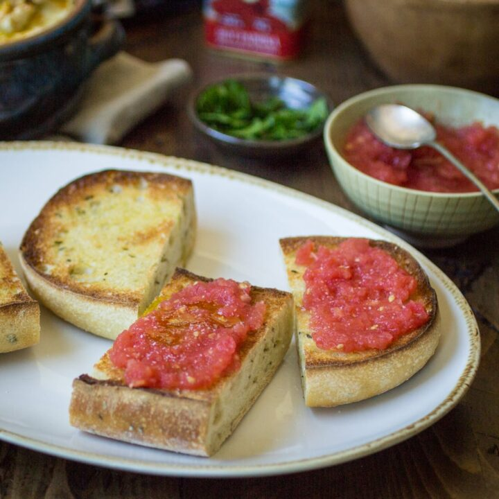 Pan con Tomate (bread with tomato) just might be the easiest-- yet tastiest!-- appetizer you'll ever make. Pair with a few Spanish tapas to create a filling and delectable meal!