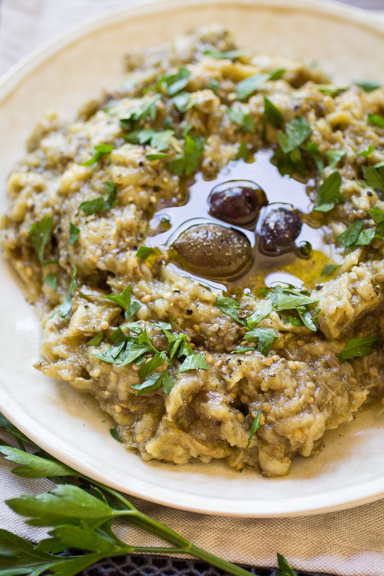 Melitzanosalata, or Greek Eggplant Dip, is a simple yet tasty dish of roasted eggplant, garlic, oil, and lemon juice. It's perfect spread on toasted bread, or as party of a larger Greek meze party!