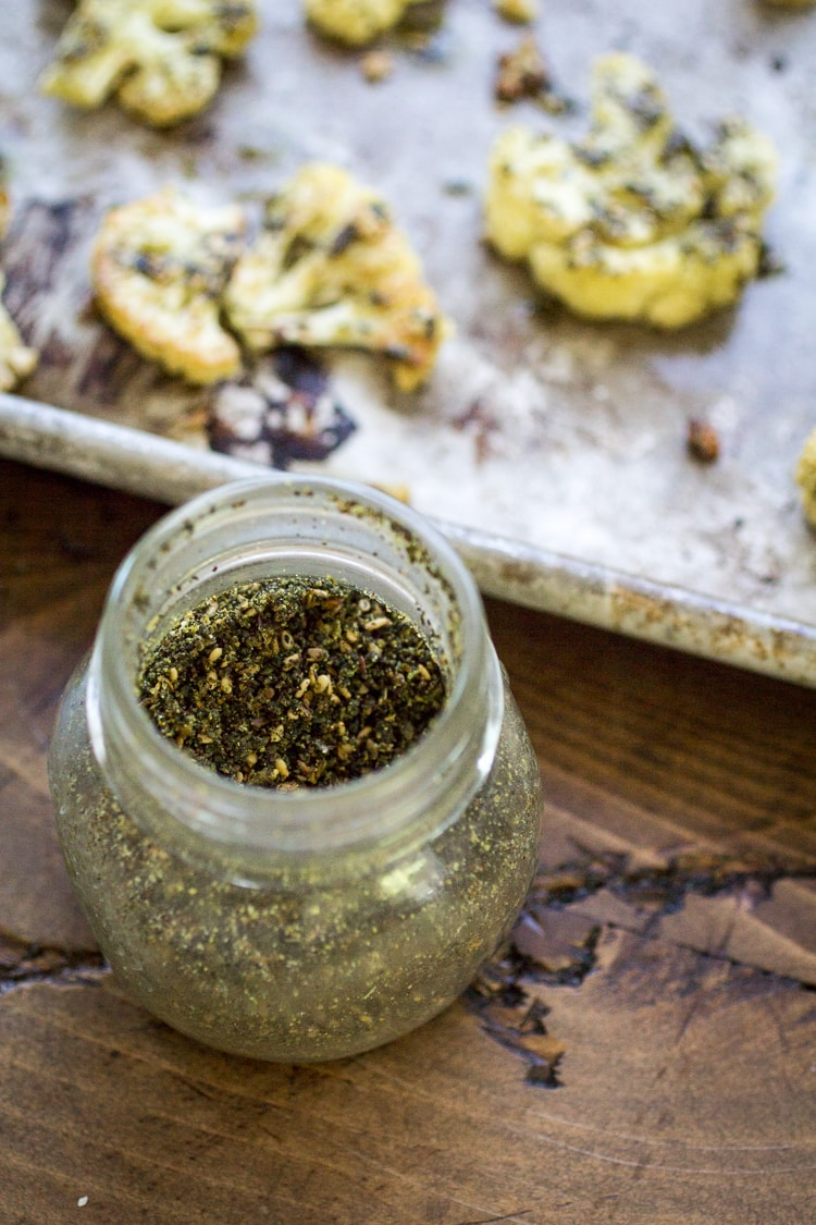 Zaatar spices turn roasted cauliflower into something special! Serve it as a side dish, stuff it in a pita, or throw it in a bowl with some chickpeas and ancient grains. Quick, easy, and delicious!