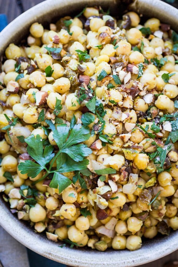 Dried dates and crunch pistachios make this Moroccan Chickpea Salad both sweet and savory!