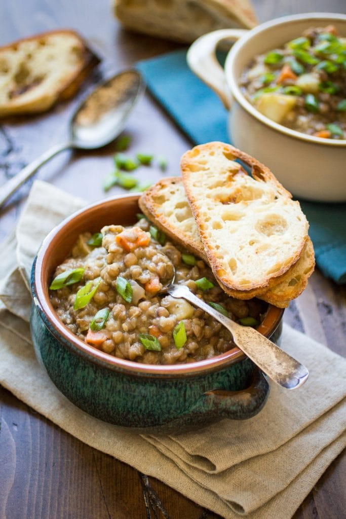 Vegan Bavarian Lentil Soup is the ultimate comfort food for cold weather and rainy days. Scoop it up with buttered crusty bread for a hearty meal!