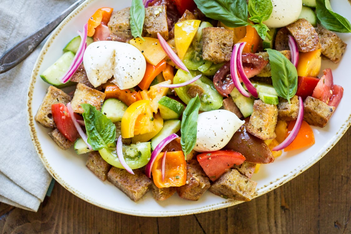 This easy Panzanella Salad recipe is a delicious mix of veggies and bread so you can enjoy the flavors of summer any time of year with this classic Italian salad!