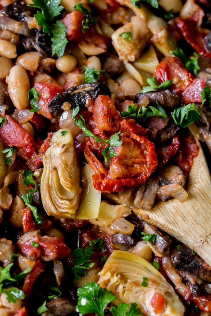 This vegetarian Tuscan White Bean Skillet recipe is made from pantry staples for a quick weeknight dinner!