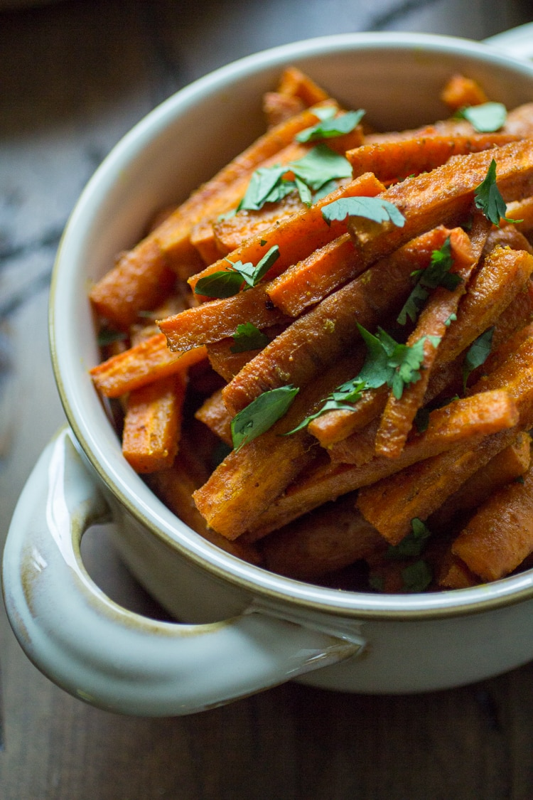 Curried Carrot Fries: Four ingredients and thirty minutes are all you need to whip up a batch of these tasty fries!