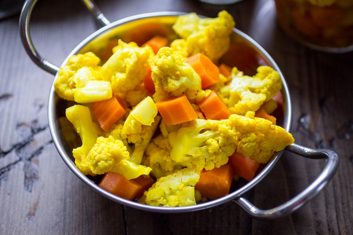A quick and easy refrigerator pickle recipe featuring curried carrots and cauliflower!