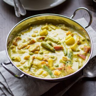 This delectable Indian Vegetable Korma is loaded with potatoes, tomatoes, carrots, peas. Make sure you have plenty of naan to dip in the creamy coconut sauce!