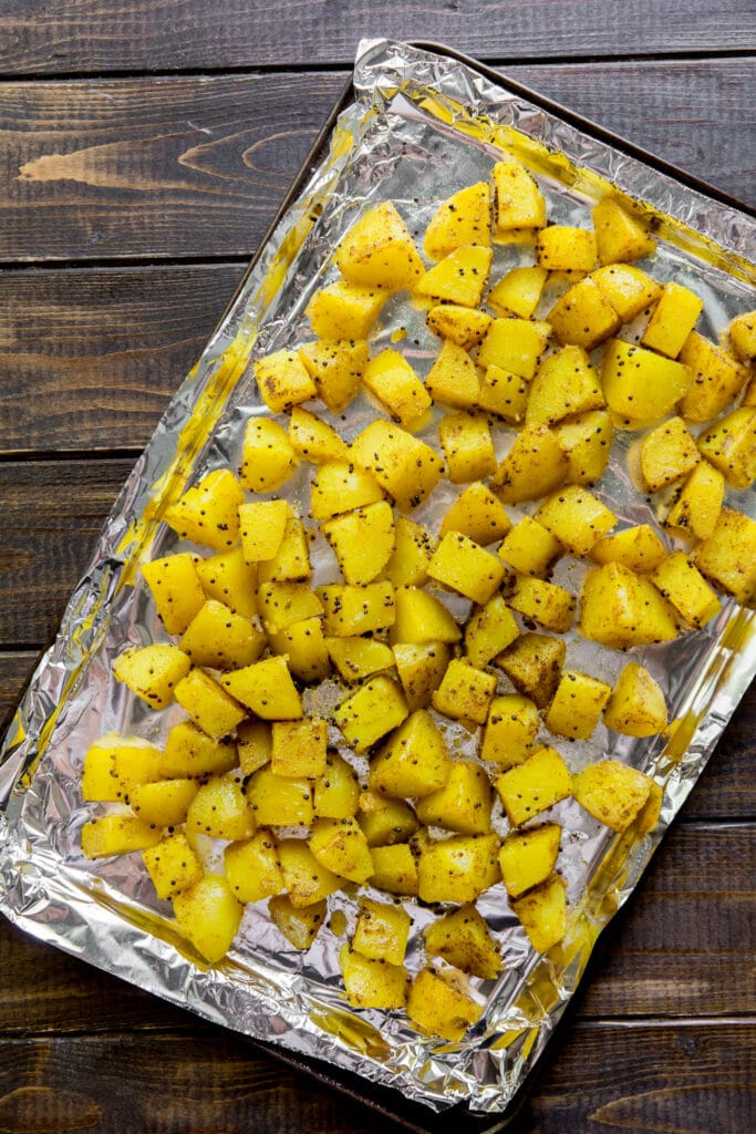 Crispy on the outside, fluffy on the inside, and richly spiced with Indian flavors — this Bombay Potatoes recipe is the perfect side dish for any Indian meal!