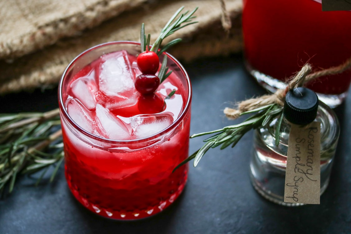 If you've never tried a vodka cranberry spritzer, here's your chance! All you need is a bag of cranberries, a bottle of vodka, and a blender. For this recipe I've added homemade rosemary simple syrup to create a festive holiday cocktail!