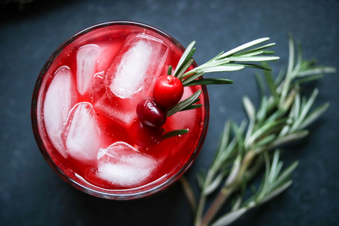 If you've never tried a rosemary cocktail vodka, here's your chance! All you need is a bag of cranberries, a bottle of vodka, and a blender. For this recipe I've added homemade rosemary simple syrup to create a festive holiday cocktail!