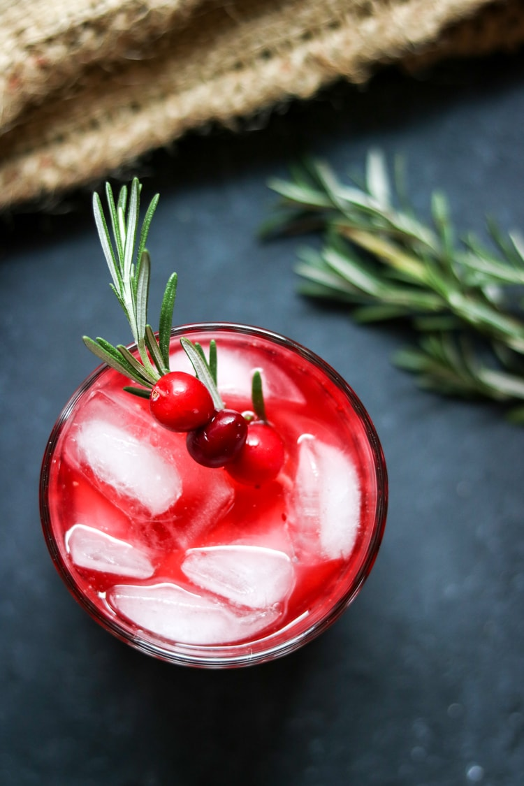If you've never tried a fresh rosemary cranberry cocktail, here's your chance! All you need is a bag of cranberries, a bottle of vodka, and a blender. For this recipe I've added homemade rosemary simple syrup to create a festive holiday cocktail!