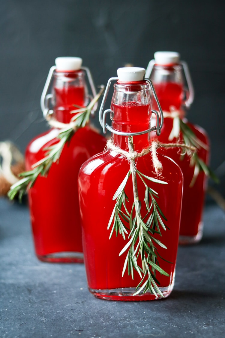 If you've never tried a fresh cranberry vodka, here's your chance! All you need is a bag of cranberries, a bottle of vodka, and a blender. For this recipe I've added homemade rosemary simple syrup to create a festive holiday cocktail!