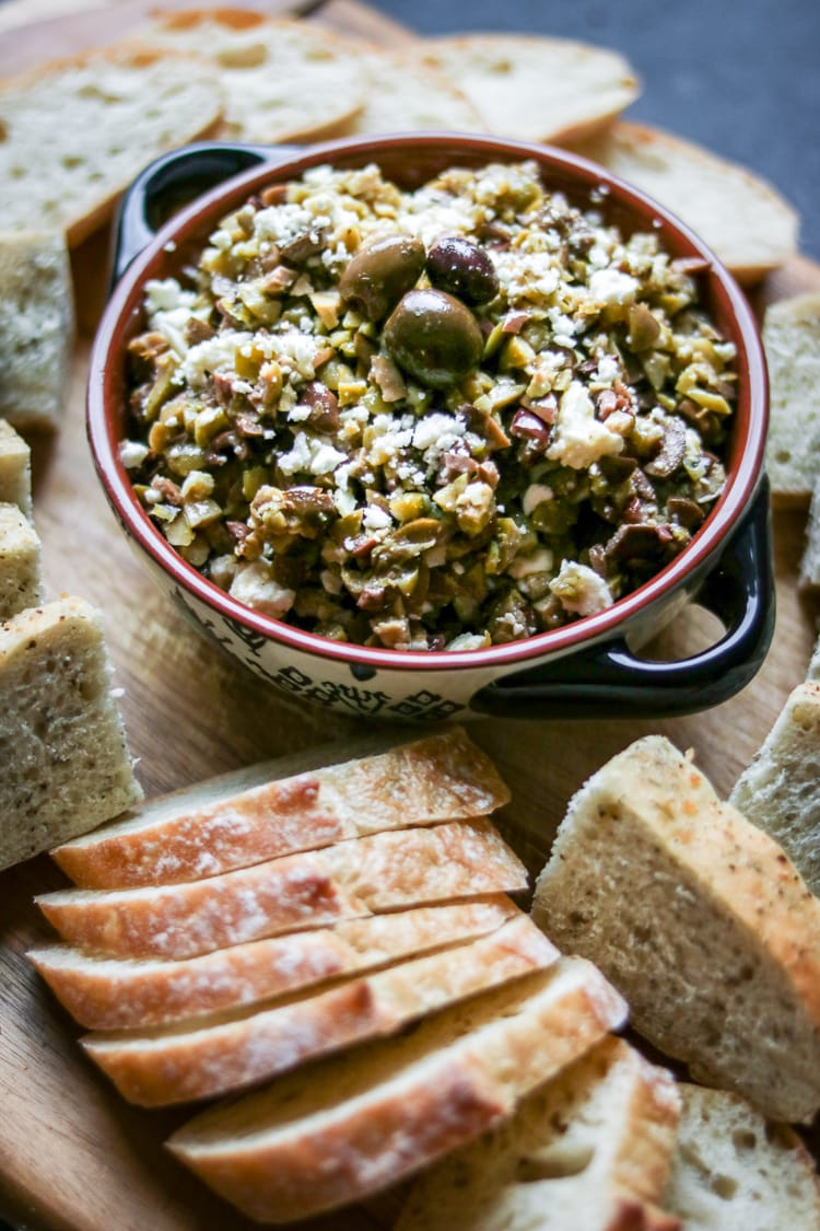 This chunky olive tapenade recipe is flavored with lemon-infused olive oil and tangy feta, a delicious and memorable party appetizer!