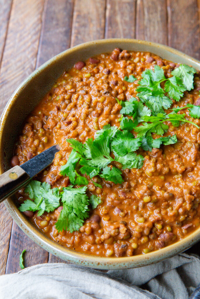 Looking for lentils madras? This Madras Lentils recipe is so good you will want to whip up a big pot and stock your freezer with a week's worth of lunches!