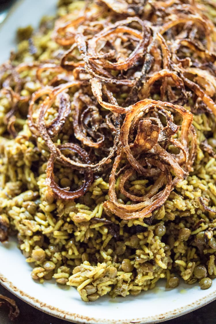 Humble lentils and rice are taken over the top with warm spices and fried onions in this classic Mejadra recipe!