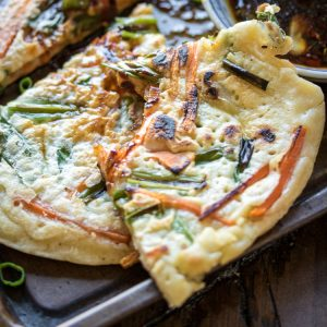 Looking for an easy dinner idea? Make Pajeon: combine leftover vegetables with a simple batter and fry up some Korean Savory Pancakes!