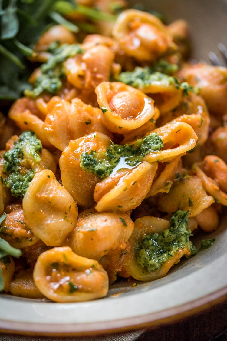 Tender beans cozy up with hearty pasta and fragrant pesto in this easy and delicious thirty-minute White Bean Pasta recipe.