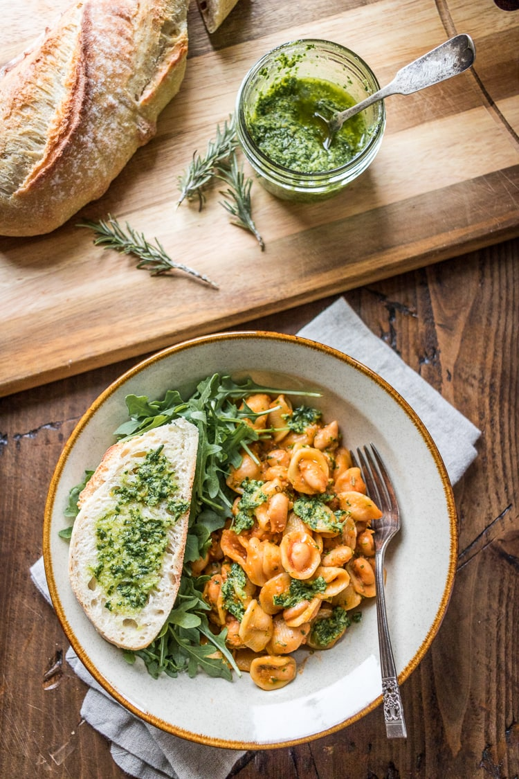 Tender beans cozy up with hearty pasta and fragrant pesto in this White Bean Pasta recipe - a 30 minute weeknight meal!