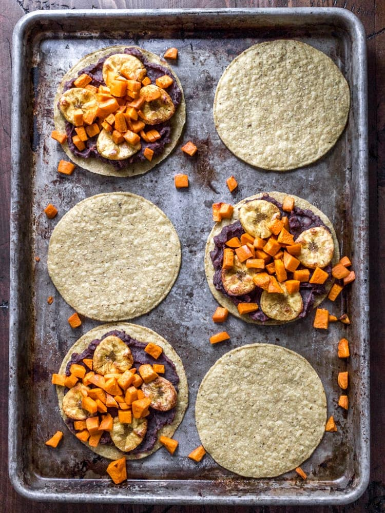 Roasted Plantain and Sweet Potato Tostadas -- Throw some plantains and sweet potatoes in the oven and the hard part is over.