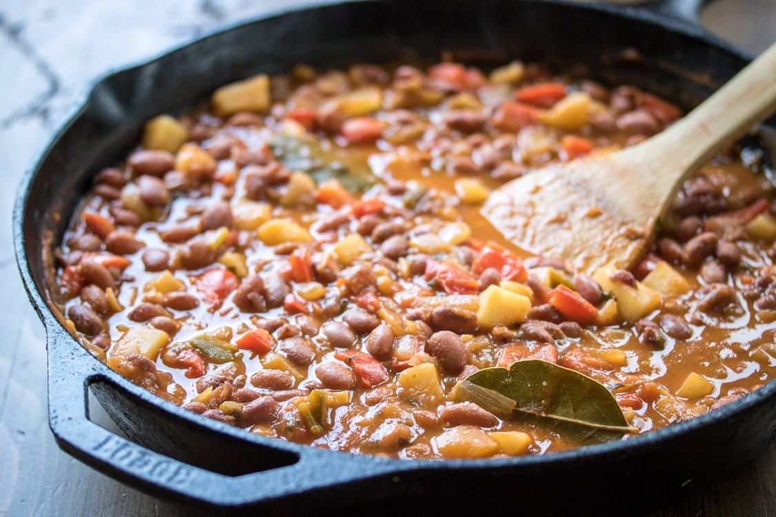 This hearty dish of Saucy Puerto Rican Beans and Potatoes is perfect served over rice for a complete vegetarian meal!