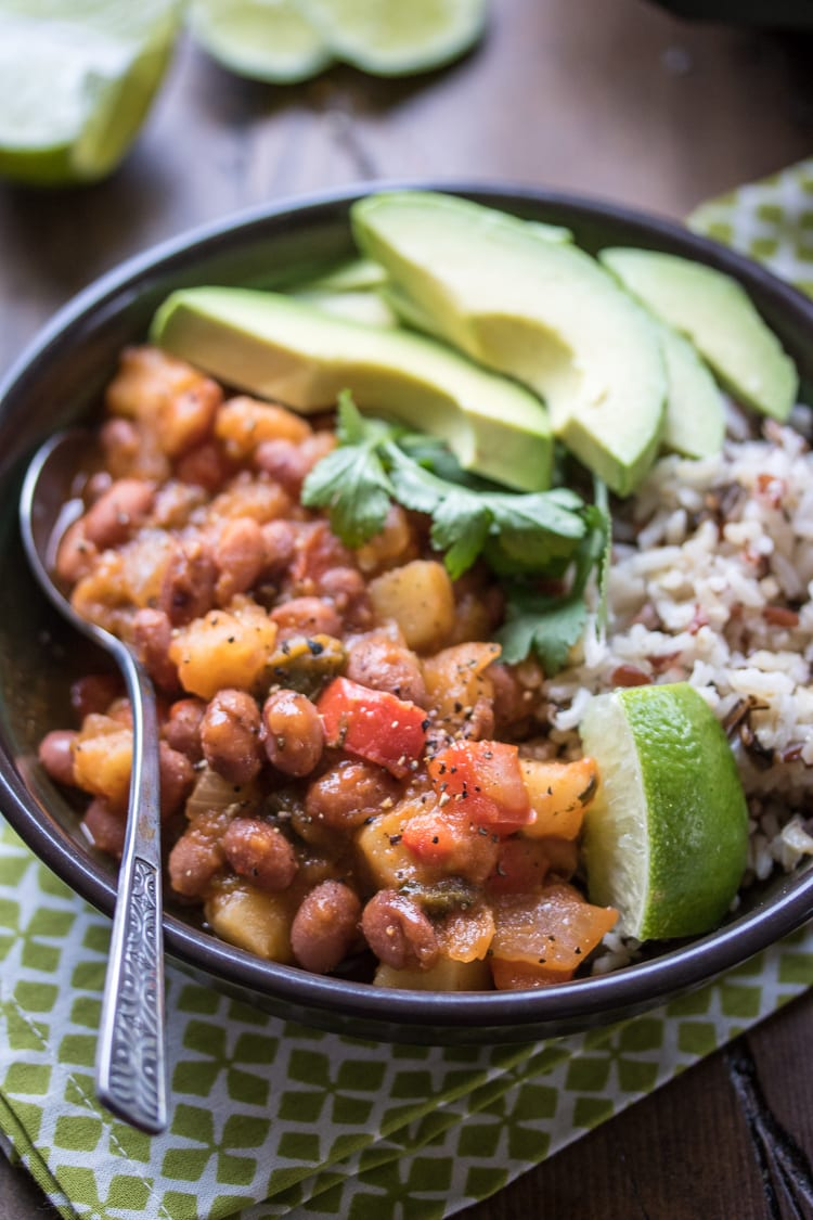 This hearty dish of Saucy Puerto Rican Beans and Potatoes is perfect served over rice for a complete vegetarian meal! I love this Puerto Rican red beans and rice recipe!