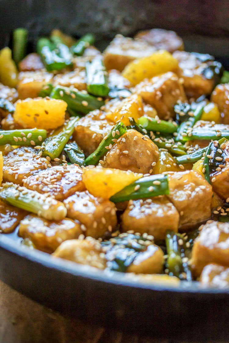 Sesame Orange Tofu - crispy tofu, luscious orange sauce, and bites of fresh citrus. Perfection in a pan!