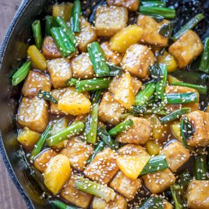 Sesame Orange Tofu - crispy tofu, luscious orange sauce, and bites of fresh orange. Perfection in a pan!
