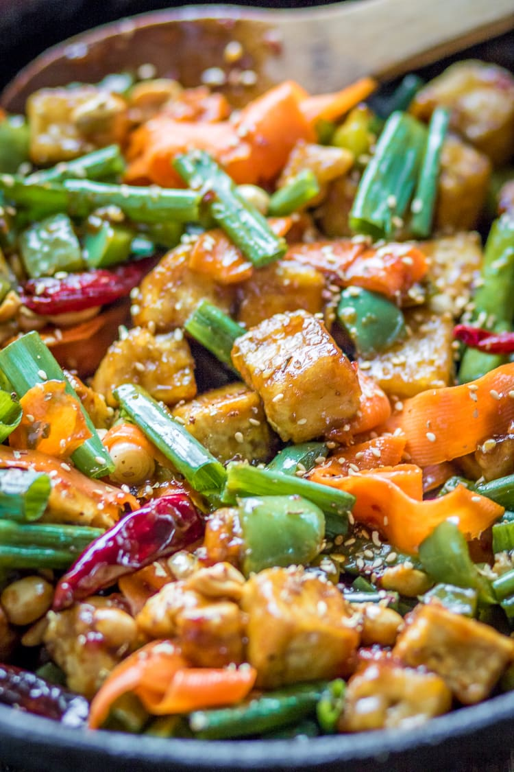 Looking for tofu stir fry recipes? Here is a great one to try! This spicy Tofu Hoisin Sauce Stir Fry recipe is loaded with veggies and covered in a sticky sauce.