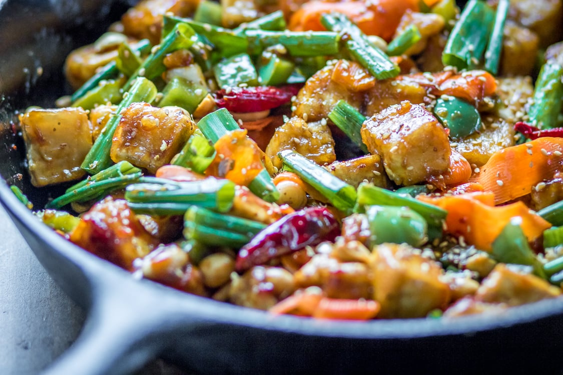 This spicy Tofu Hoisin Stir Fry is loaded with veggies and covered in a sticky sauce.