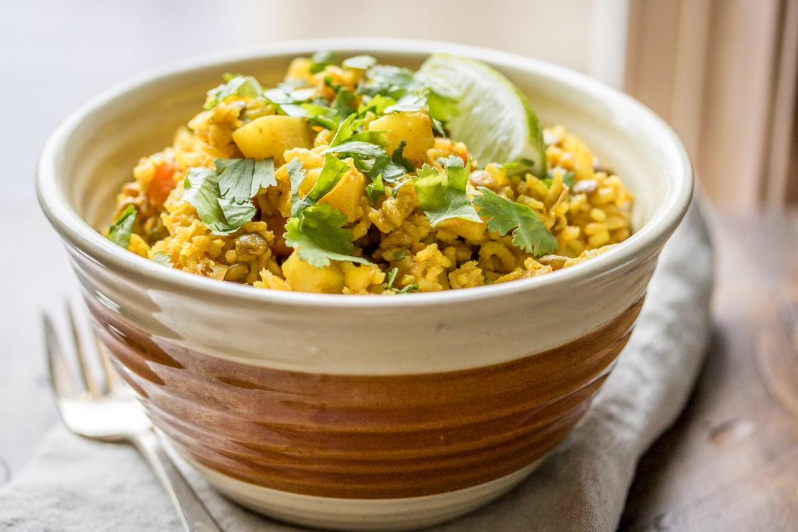 Lentils, rice, potatoes, carrots, and LOTS of herbs and spices make this one-pot meal a dinnertime champion!