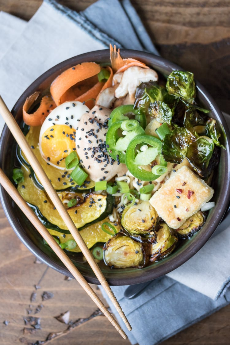 What veggies for ramen? Check out this vegetable ramen recipe for the answer! A hearty bowl of winter vegetable ramen is just the thing to warm you up! Make it on the stove top for a quick weeknight dinner, or prepare the broth in the slow cooker ahead of time (and make some soft boiled ramen eggs!)