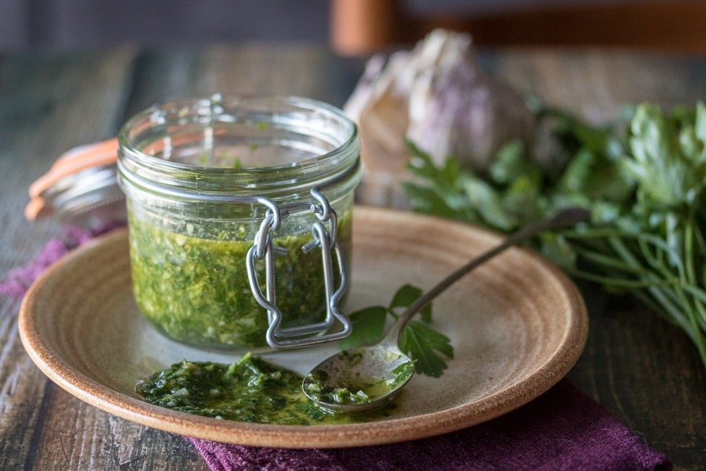 There's nothing like this easy chimichurri sauce to brighten up your favorite dish! Five minutes and a basic food processor are all you need to put together this delicious and versatile condiment.  Want to learn how to make a Chimichurri sauce?  This recipe will show you.